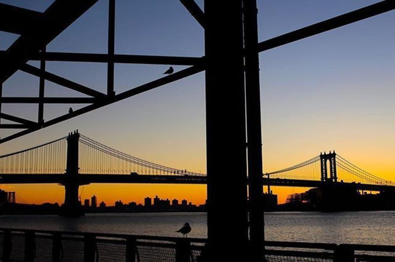 Sunrise under the Manhattan Bridge. New York, New York. Photo via @juliansilvermanphoto #viewingnyc #newyorkcity #newyork #nyc