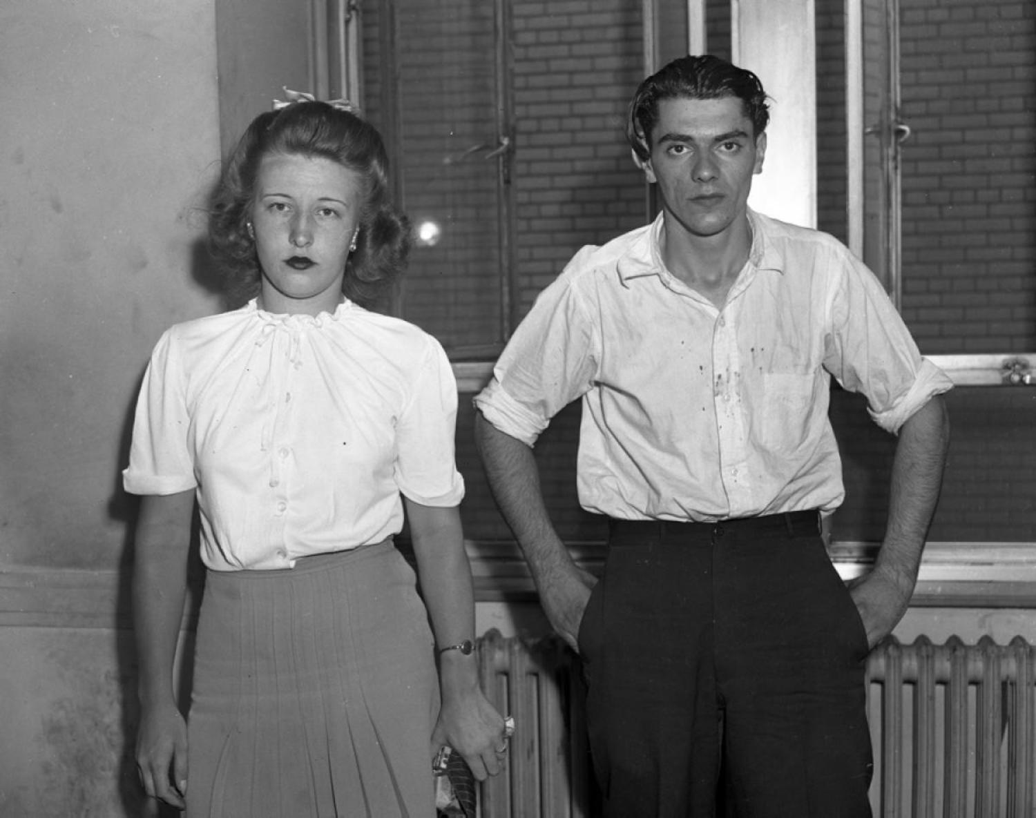Mob Moll, 1944: She stands by her man! 19-year-old Virgina Ornmark looks unfazed as she and beau Fred Schmidt, 24, stare blankly at the camera after being arraigned for the murder of a lingerie merchant in 1944.