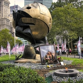 Battery Park - The Sphere |     *  The Sphere      * Dedicated March 11, 2002     * Description: Temporary Installation of artwork salvaged from WTC Disaster Site. The 25' high sphere stood in the WTC Plaza as a monument to world peace from 1971 to September 11, 2001.